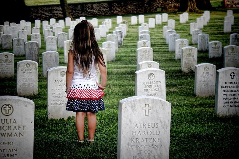 Memorial Day girl in cemetary